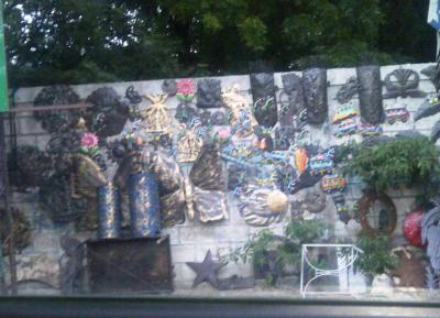 Haitian Art hanging on a wall next to the road