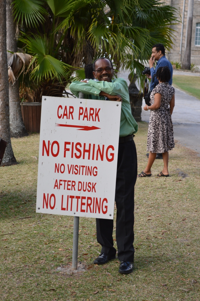 Not sure why my friend seems so happy about this particular sign | Codrington College, Barbados