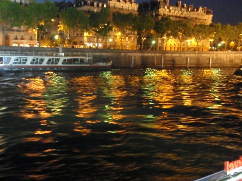 On the water in Paris at night, liquid rainbow