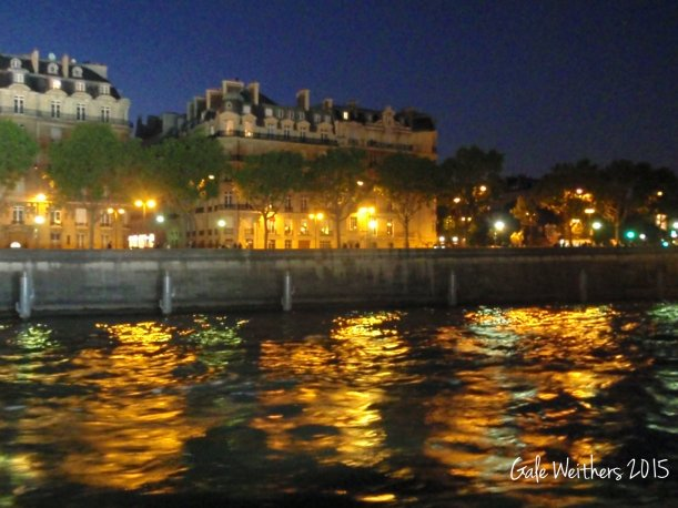 Paris on the water by night