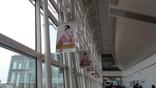 Tokyo Japan, face of girl at airport selling perfume in poster