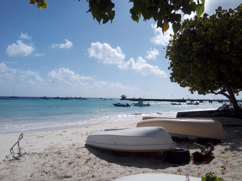 oistins beach barbados with boats